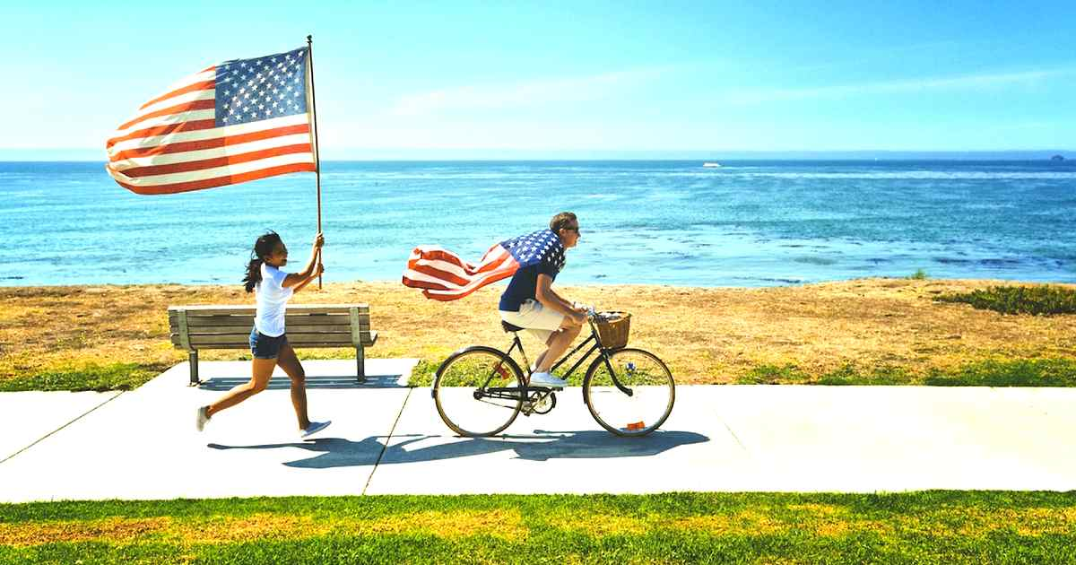 conservative political values - people with flags on bike